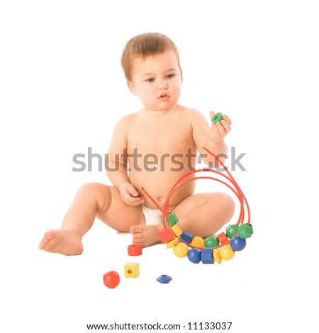 A toddler playing with a multicolored toy - stock photo