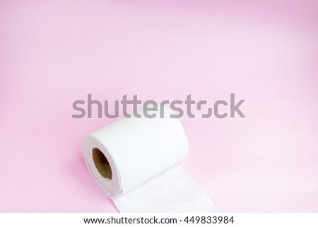 a toilet paper on the pink background with copy space