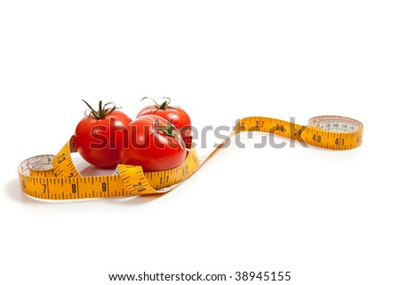 a tomato with a tape measure