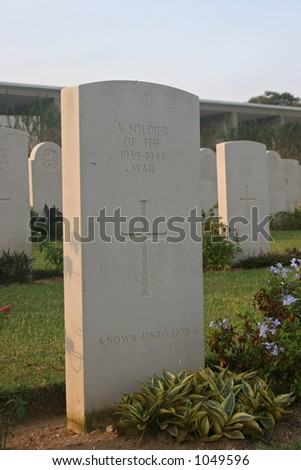 A tomb stone for an unknown soldier, Kranji war memorial, singapore - stock photo