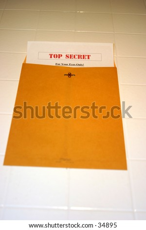A Top Secret (for your eyes only) document peeks out of a manila envelope - stock photo