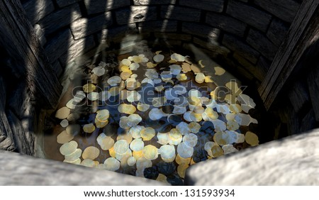 A top view looking over the edge into a brick wishing well with gold silver and bronze coins at the bottom covered in water - stock photo