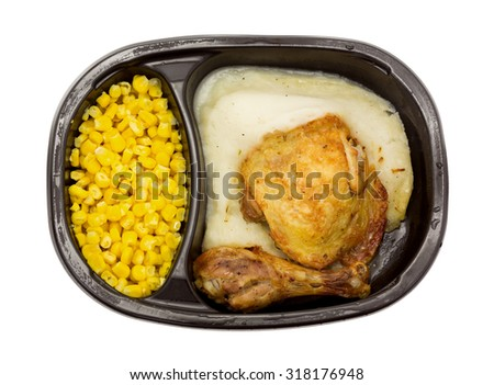A top view of a frozen TV dinner on a white background.  - stock photo