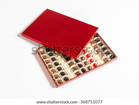 A top view of a generic chocolate box with lid and individual pieces divided into rows and columns.