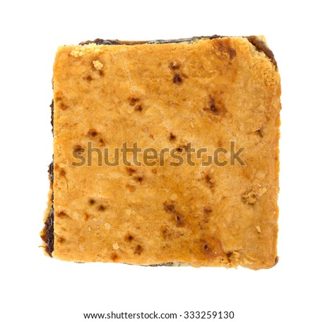 A top view of a square tasty homemade fig bar on a white background. - stock photo