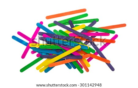 A top view of an assortment of colored craft sticks on a white background. - stock photo