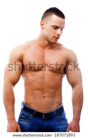 A topless masculine man in jeans