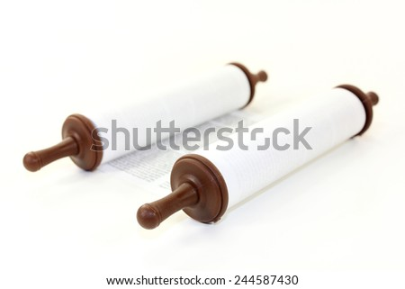 a Torah scroll in front of white background - stock photo