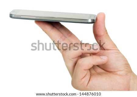 a touchscreen smartphone held with fingers - stock photo