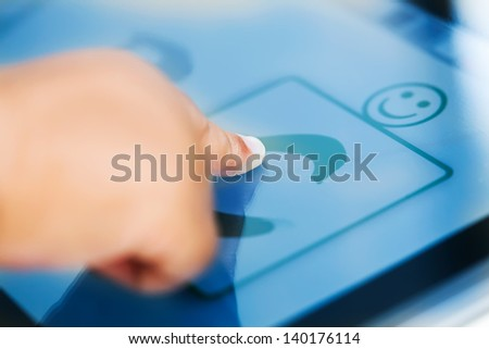A touchscreen tablet with an educational app and a child making a selection. - stock photo
