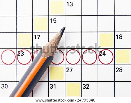 A tough crossword puzzle from the newspaper - stock photo