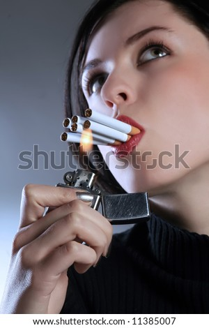 a tough lady smoker with six cigarettes - stock photo