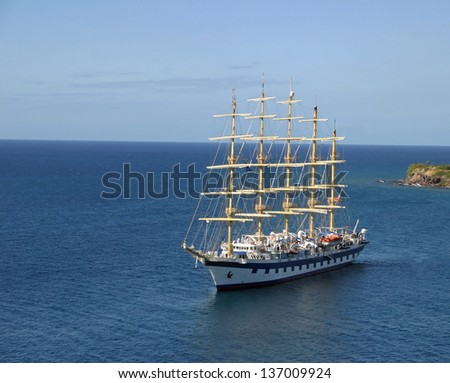 A tourist sailboat located in the Caribbean - stock photo