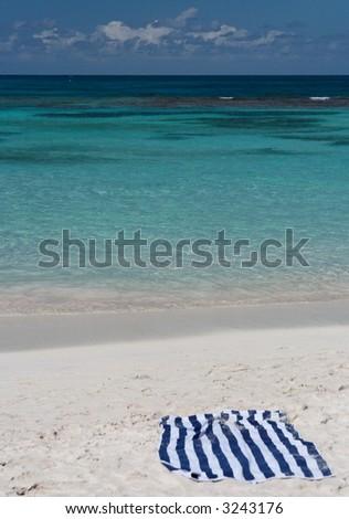 A towel on a beautiful caribbean beach - stock photo