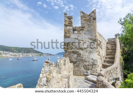 A Tower of Bodrum Castle and Bodrum harbour background, Turkey - stock photo
