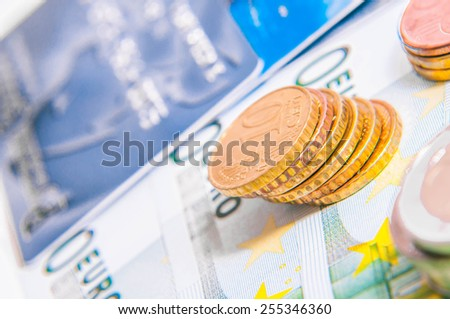 a tower of Euro coins, banknote, European currency - stock photo