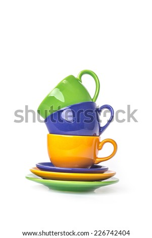 A tower of three color cups isolated on a white background - stock photo