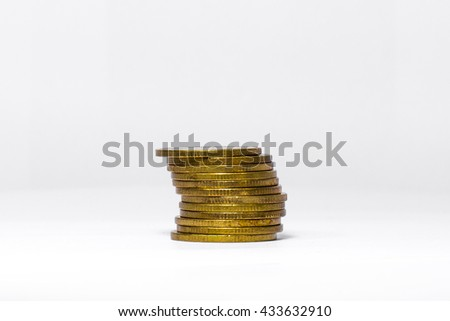 A Tower that made from leaned Golden Coins, Ladder for success, Money on a White Background (Isolated Photo) - stock photo