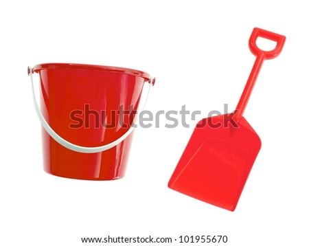 A toy bucket and spade set  isolated against a white background - stock photo