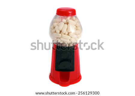A toy gum ball machine filled with white pills and drugs. Representing the dangerous access to illicit drugs. Illegal drugs are as easy to obtain as gum balls if you ask the right people. isolated  - stock photo