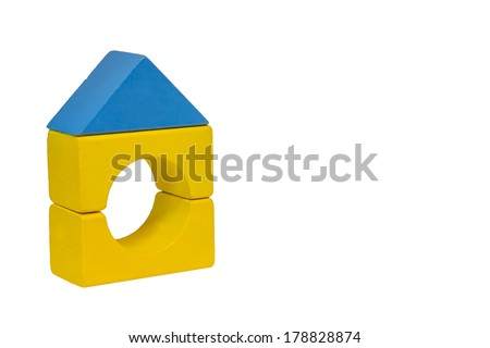 A toy house made from building blocks isolated on white background. - stock photo