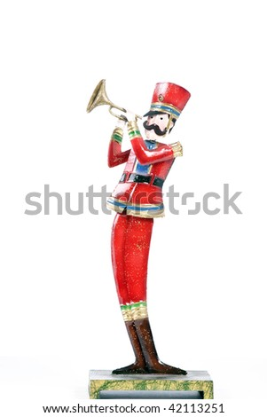 A toy soldier trumpet player isolated against a white background in the vertical format.