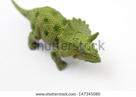 A toy Triceratops on a white background - stock photo