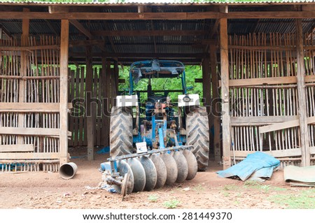 A tractor in the hut - stock photo