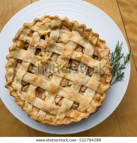 A traditional apple pie on a platter.