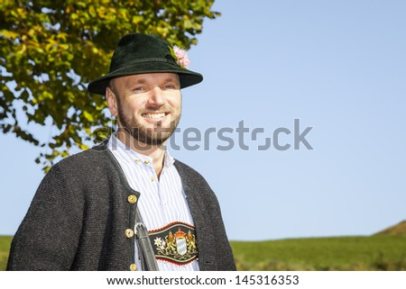 A traditional bavarian man in the autumn nature