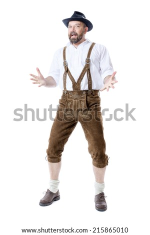 A traditional bavarian man isolated on a white background presenting something - stock photo