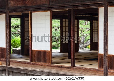 A traditional ceremonial tearoom in a Japanese garden. The wooden building has tatami mats, sliding paper screen doors ( Shoji ) and wooden terraces overlooking the garden