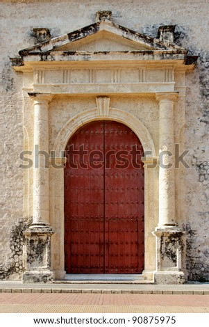 A traditional colonial era door in the streets of Cartagena de Indias, Colombia. - stock photo