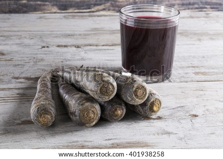 A Traditional drink Salgam with purple carrot on wooden background. - stock photo