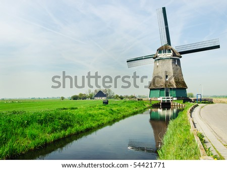 A traditional Dutch windmill near the canal. Netherlands