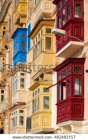 A traditional Maltese style different colored  balconies in Valletta. Malta.