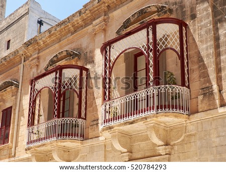 A traditional Maltese style openwork balconies on one of the residential houses of Mdina. Malta.