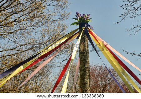A traditional maypole dance during a May Day celebration
