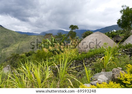 A traditional mountain village in Papua, Indonesia. - stock photo
