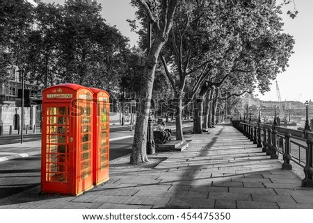 A traditional red phone booth in London - stock photo