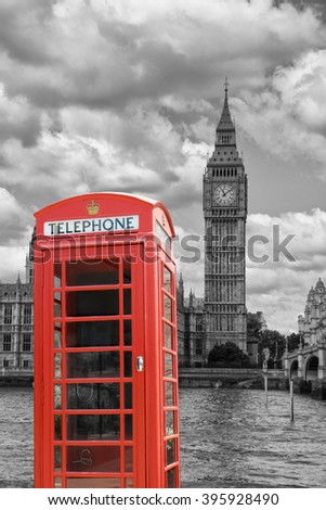 A  traditional red phone booth in London with the Big Ben - stock photo