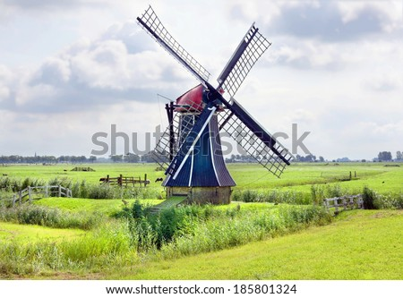 A traditional windmill on the countryside in the Netherlands - stock photo