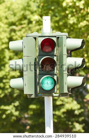 A traffic light directing traffic at an intersection. - stock photo