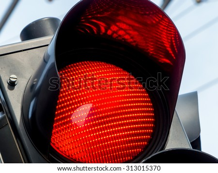 a traffic light shows red light on the road. - stock photo