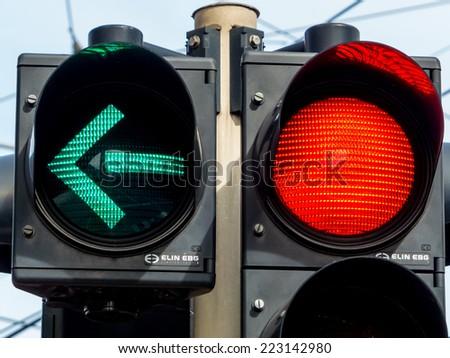 a traffic light with retoem light. green light for traffic turning left. - stock photo