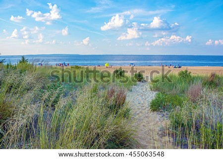 A trail leading to the Keansburg Beach, a free beach along the Jersey shore with a distant view of Manhattan. - stock photo