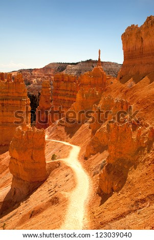 A trail through the spectacular orange landscape of Bryce Canyon, Utah, USA - stock photo