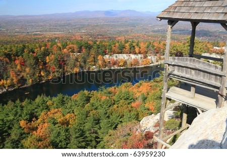 A trailside gazebo with a fantastic Autumn view of Mohonk Lake and the surrounding Shawangunk Mountains with the Catskills Mountains in the distance ,in New York State