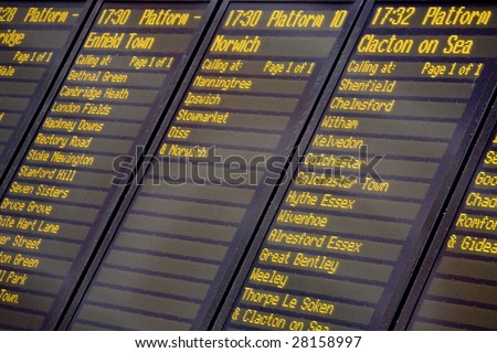 A train departures board and timetable, Liverpool Street railway station, London UK