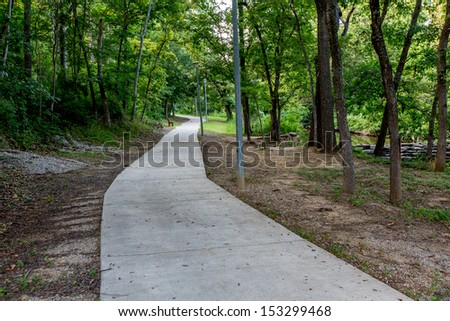 A Tranquil Spring or Summer Wooded Nature Outdoor Scene.  Wooded walkway. - stock photo